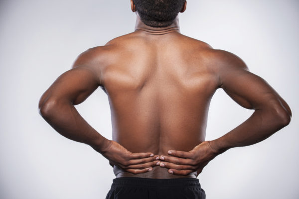 Болит спина у человека